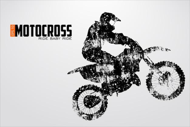 Silhouette eines motocross-fahrers Premium Vektoren