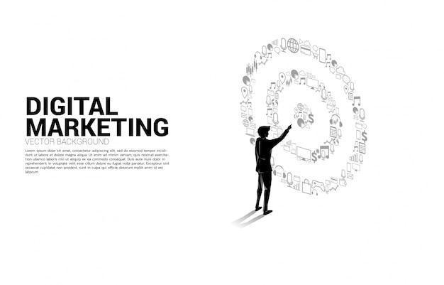 Silhouette geschäftsmann punkt in der mitte der dartscheibe von marketing-ikone. geschäftskonzept von marketingziel und kunde