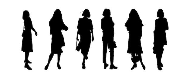 Silhouetten einer gruppe junger mädchenmodelle, die in moderner kleidung posieren. zum drucken und laserschneiden. vektor-illustration.