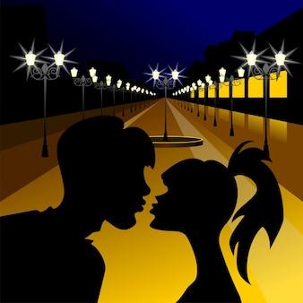 Silhouetten küssen ein mädchen und einen mann gegen den abend den boulevard mit laternen