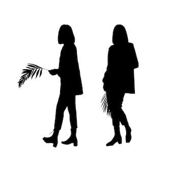 Silhouetten von zwei jungen mädchen von modellen, die mit einem palmblatt posieren. zum drucken und laserschneiden. vektor-illustration.