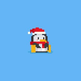 Sitzender pinguin des pixels mit sankt-hut und rotem schal