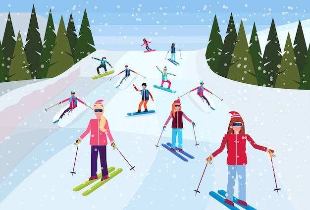Skifahrer rutschen den berg hinunter