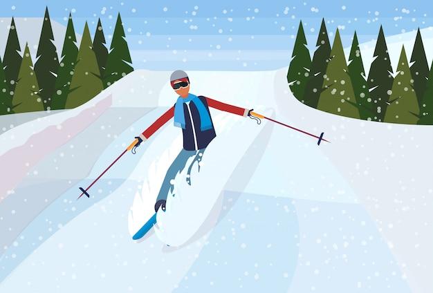 Skifahrermann, der den berg hinunter rutscht