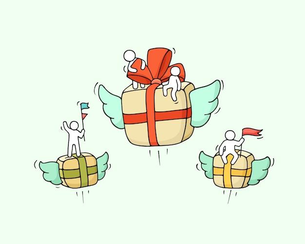 Skizze der fliegenden geschenkbox mit kleinen arbeitern.