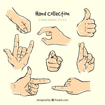 Skizzen von zeichen mit den händen festgelegt