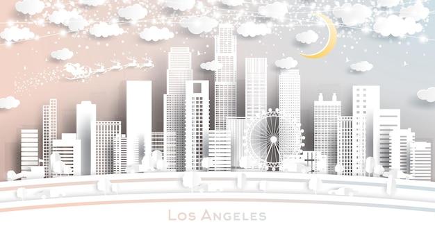 Skyline von los angeles usa im scherenschnitt-stil mit schneeflocken, mond und neon-girlande. weihnachts- und neujahrskonzept. weihnachtsmann auf schlitten.