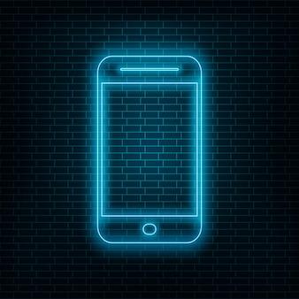 Smartphone mit neoneffekt, blaues neontelefon auf wand
