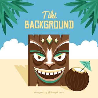 Smiley-tiki-maske mit kokos-cocktail