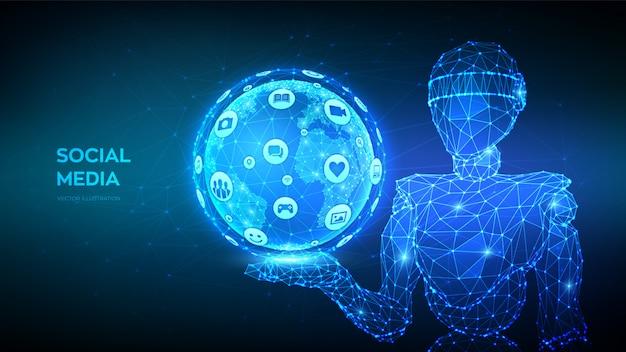 Social-media-verbindungskonzept. abstrakter niedriger polygonaler roboter, der erdkugel mit verschiedenen sozialen medien und computerikonen hält.