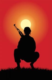 Soldat mit gewehrfigurschattenbild bei sonnenuntergangsszene
