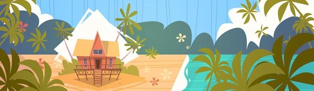 Sommer-ferien-bungalow-haus auf seestrand-landschaftsschöner meerblick-fahnen-küsten-feiertag