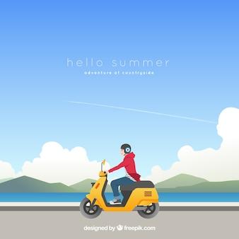 Sommerhintergrund mit jungen auf einem motorrad