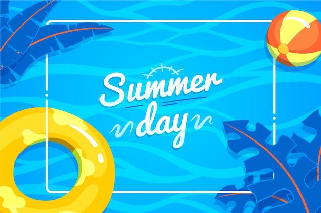 Sommerhintergrund mit wasserball und blättern