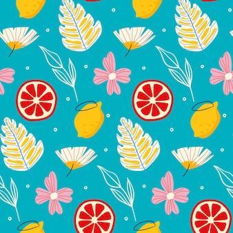 Sommermuster mit blumen und grapefruits
