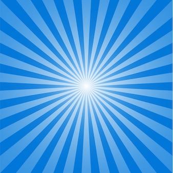 Sonne und strahlen auf blauem hintergrund.