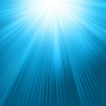 Sonnenstrahlen auf vorlage des blauen himmels. datei enthalten
