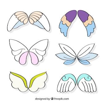 Sortiment von dekorativen flügeln mit farbigen elementen