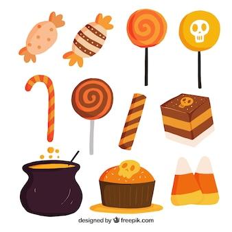 Sortiment von halloween süßigkeiten und kuchen