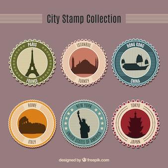 Sortiment von sechs runden briefmarken mit schönen städten