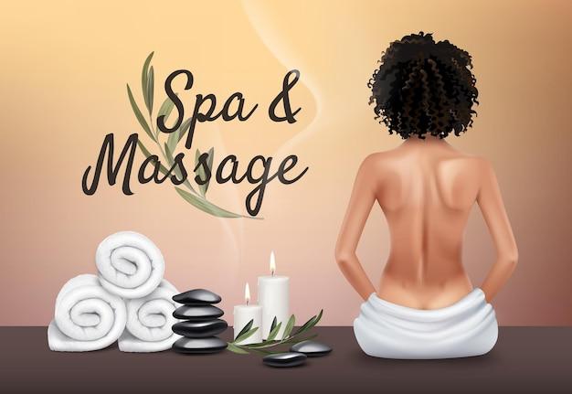 Spa und massage. junges mädchen, handtücher, massagesteine, kerzen.