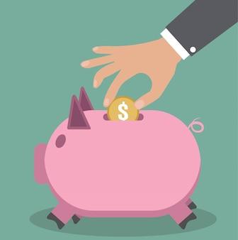 Sparschwein und hand mit münze