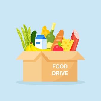Spendenbox mit essen für hungernde menschen. verschiedene lebensmittelprodukte für obdachlose im tierheim.