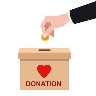 Spendenbox mit menschlicher hand goldene münze einlegen, geld. einzahlung in einen kartonbehälter mit textbanner spenden.