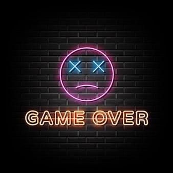 Spiel über neonzeichen-stil-text auf einem schwarzen wandhintergrund