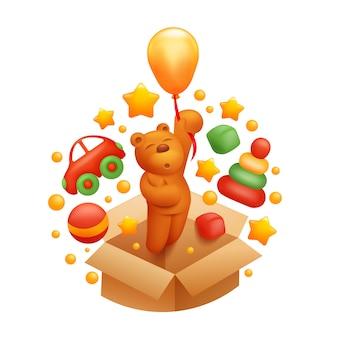 Spielzeugkiste mit autopyramidenball und fliegendem bären auf ballon