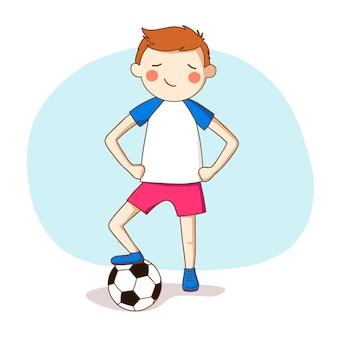 Sport. rothaariger junge in sportuniform mit einem fußball.