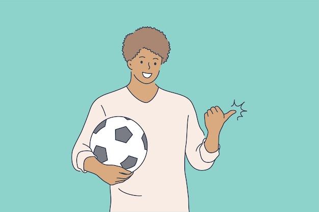 Sport, werbung, fußball, spielkonzept. junger glücklicher lächelnder afroamerikanermann-typjunge-jungencharakter-fußballspielermann, der mit ball und daumen oben steht
