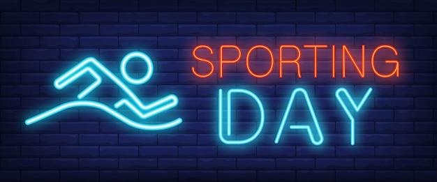Sporting day leuchtreklame. leuchtende balkenschrift mit schwimmendem mann