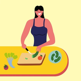 Sportlerin schneidet gurkensalat in scheiben
