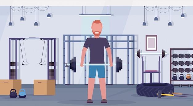 Sportlicher mann, der langhantel mit gewichten bodybuilder-training im fitnessstudio hebt, erarbeitet ein konzept für einen gesunden lebensstil des modernen health club-studios, das horizontal flach ist