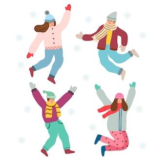 Springende menschen in winterkleidung