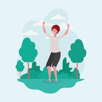 Springendes feiern des jungen mannes im parkcharakter