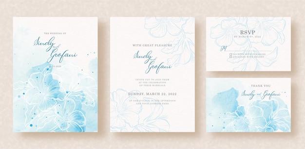 Spritzen sie blaues aquarell mit blütenblumen auf hochzeitseinladung