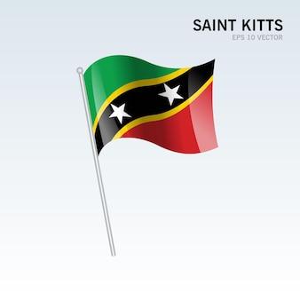 St. kitts wehende flagge isoliert auf grau