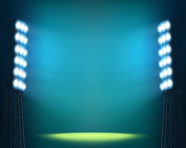 Stadionlichter gegen dunklen nächtlichen himmel
