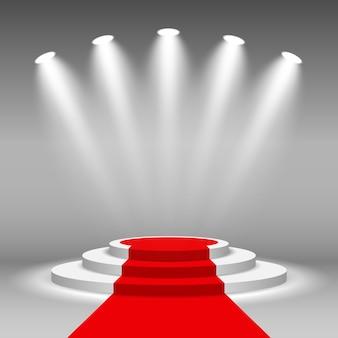 Stadiums-podium beleuchtete szenenscheinwerfer mit rotem teppich