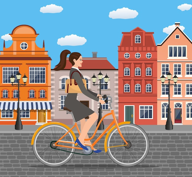 Stadtartgeschäftsdame mit tasche, die fahrrad die straßen der altstadt reitet