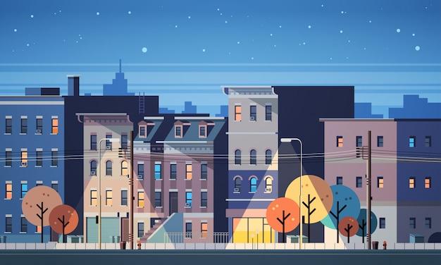 Stadtgebäude beherbergt nachtansicht-skylinehintergrund