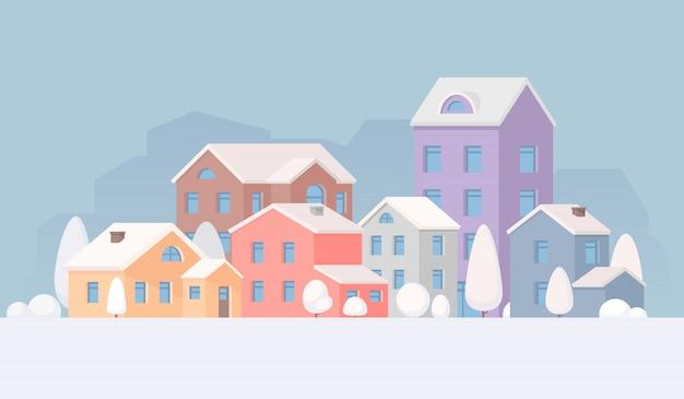Stadtlandschaft im winter. stadt, dorf. häuser und bäume im schnee