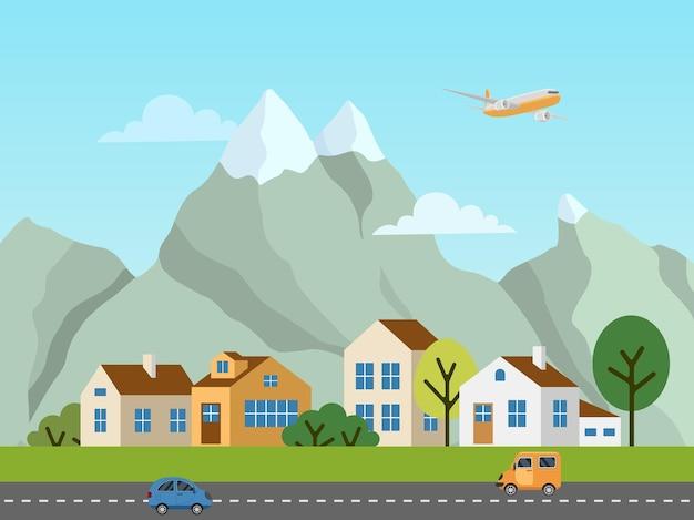 Stadtlandschaft. panorama von hütten vor bergen. flugzeug am himmel, autos auf der straße.