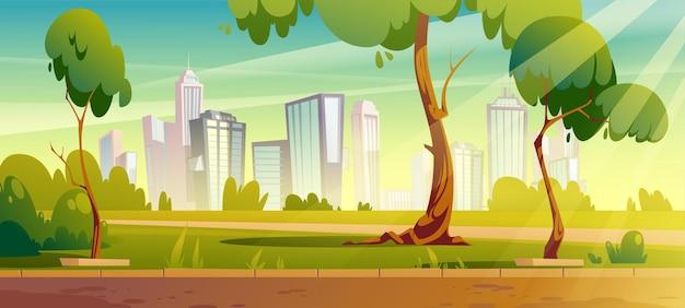 Stadtpark mit grünen bäumen und rasen