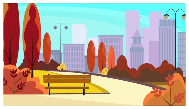 Stadtparkgehweg mit herbstbäumen, büschen, bänke, laternen