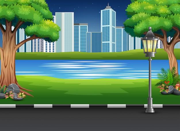 Stadtparklandschaft mit fluss und städtischem hintergrund