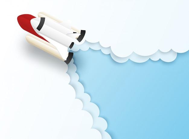 Start-business-konzept. entwerfen sie mit raumfahrzeugen, raketenfliegen im blauen himmel.
