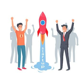 Startrakete im startup. glückliche und fröhliche männer